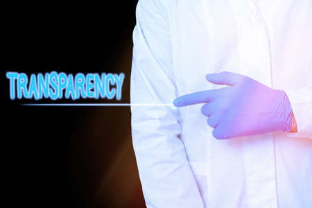 Conceptual hand writing showing Transparency. Concept meaning something transparent especially a picture viewed by light Displaying Sticker Paper Accessories With Medical Gloves On