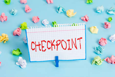 Handwriting text Checkpoint. Conceptual photo manned entrance, where travelers are subject to security checks Colored crumpled papers empty reminder blue floor background clothespin