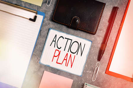 Handwriting text Action Plan. Conceptual photo detailed plan outlining actions needed to reach goals or vision Paper accesories with digital smartphone arranged on different background