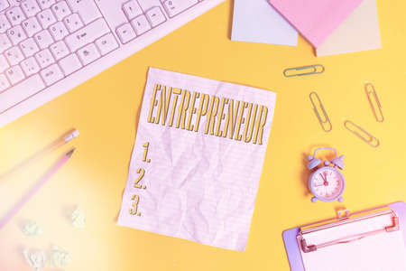 Writing note showing Entrepreneur. Business concept for one who organizes and assumes the risks of a business Flat lay above copy space on the white crumpled paper