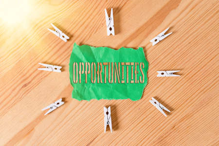 Text sign showing Opportunities. Business photo text good chance for advancement, favorable juncture circumstance Colored clothespin papers empty reminder wooden floor background office