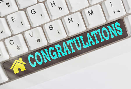 Text sign showing Congratulations. Business photo showcasing a congratulatory expression usually used in plural form Different colored keyboard key with accessories arranged on empty copy space