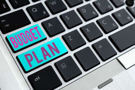 Writing note showing Budget Plan. Business concept for financial schedule for a defined period of time usually year Different Colored PC keyboard key With Accessories on Empty background