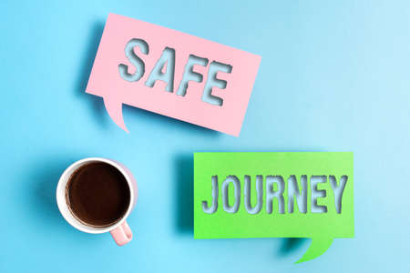 Handwriting text Safe Journey. Conceptual photo Blessing Bid farewell Drive carefully Use seatbelt Strap Paper accesories with digital smartphone arranged on different background