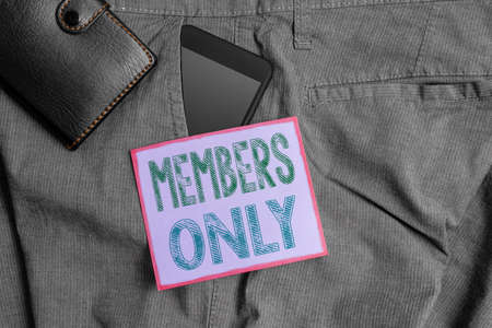 Handwriting text Members Only. Conceptual photo Limited to an individual belongs to a group or an organization Smartphone device inside trousers front pocket with wallet and note paper