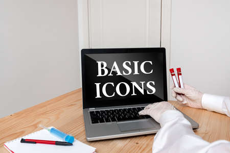 Writing note showing Basic Icons. Business concept for pictogram or ideogram displayed on a computer screen or phone Blood sample vial lastest technology ready for examination