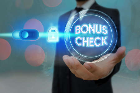 Text sign showing Bonus Check. Business photo text something in addition to what is expected or strictly due Graphics padlock for web data information security application system