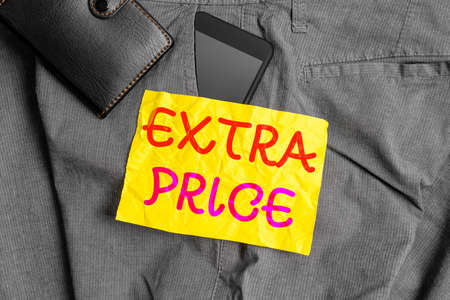 Writing note showing Extra Price. Business concept for extra price definition beyond the ordinary large degree Smartphone device inside trousers front pocket with wallet