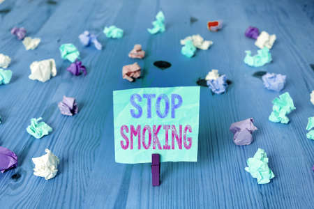 Writing note showing Stop Smoking. Business concept for Discontinuing or stopping the use of tobacco addiction Colored crumpled rectangle shaped reminder paper light blue background
