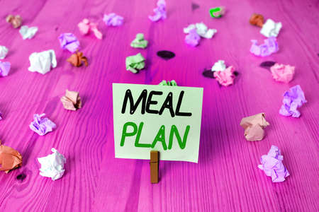 Word writing text Meal Plan. Business photo showcasing act of taking time to plan any number of meals for the week Colored crumpled rectangle shaped reminder paper light blue background