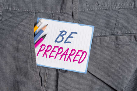 Handwriting text Be Prepared. Conceptual photo make something ready for use or consideration at future Writing equipment and white note paper inside pocket of man work trousers