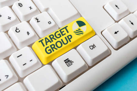 Conceptual hand writing showing Target Group. Concept meaning Particular showing that an advertisement intended to reach to Colored PC keyboard key With Accessories on Empty background