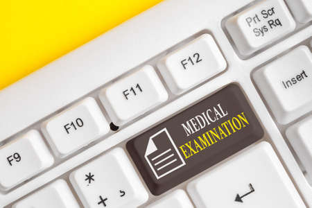 Word writing text Medical Examination. Business photo showcasing the examination carried out to determine physical fitness Different colored keyboard key with accessories arranged on empty copy space 版權商用圖片