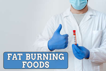 Word writing text Fat Burning Foods. Business photo showcasing produce fat loss by stimulating metabolism to reduce appetite Laboratory Blood Test Sample Shown For Medical Diagnostic Analysis Result