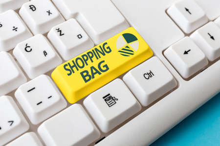 Conceptual hand writing showing Shopping Bag. Concept meaning Containers for carrying an individualal possessions or purchases Colored PC keyboard key With Accessories on Empty background