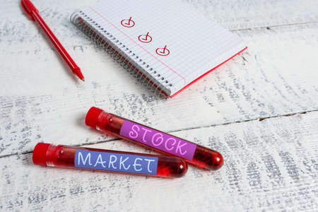 Handwriting text Stock Market. Conceptual photo Particular market where stocks and bonds are traded or exhange Extracted blood sample vial with medical accessories ready for examination