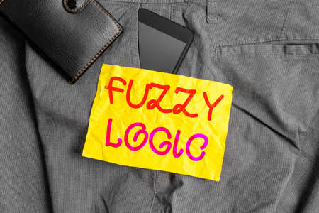 Writing note showing Fuzzy Logic. Business concept for checks for extent of dirt and grease amount of soap and water Smartphone device inside trousers front pocket with wallet Banque d'images