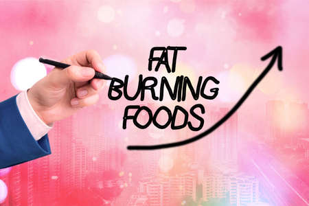 Conceptual hand writing showing Fat Burning Foods. Concept meaning produce fat loss by stimulating metabolism to reduce appetite Digital arrowhead curve denoting growth development concept