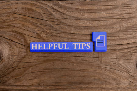 Word writing text Helpful Tips. Business photo showcasing Ask an Expert Solutions Hints Consulting Warning Different Colored PC keyboard key With Accessories on Empty background