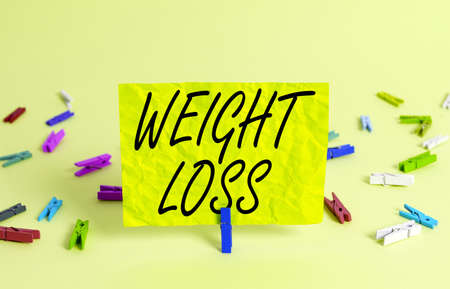 Text sign showing Weight Loss. Business photo text a reduction of the total body mass due to a mean loss of fluid Colored crumpled rectangle shaped reminder paper light blue background