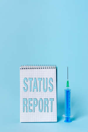 Writing note showing Status Report. Business concept for summarizes the particular situation as of a stated period Set of medical equipment with notepad for health condition assessment