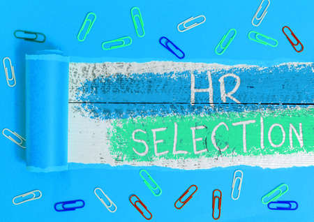 Text sign showing Hr Selection. Business photo showcasing Process and approached by resources when hiring employees Rolled ripped torn cardboard placed above a wooden classic table backdrop