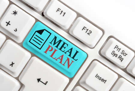 Word writing text Meal Plan. Business photo showcasing act of taking time to plan any number of meals for the week Different colored keyboard key with accessories arranged on empty copy space