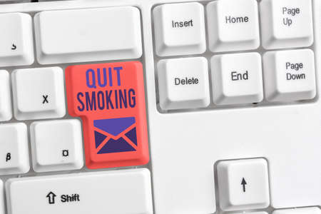 Handwriting text Quit Smoking. Conceptual photo Discontinuing or stopping the use of tobacco addiction Different colored keyboard key with accessories arranged on empty copy space