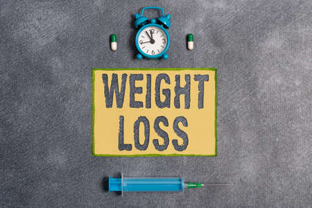 Word writing text Weight Loss. Business photo showcasing a reduction of the total body mass due to a mean loss of fluid Set of medical equipment with notepad for health condition assessment 版權商用圖片