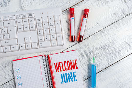 Text sign showing Welcome June. Business photo text Calendar Sixth Month Second Quarter Thirty days Greetings Extracted blood sample vial with medical accessories ready for examination