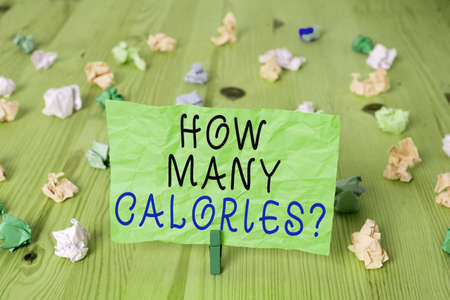 Word writing text How Many Calories Question. Business photo showcasing asking how much energy our body could get from it Colored crumpled rectangle shaped reminder paper light blue background