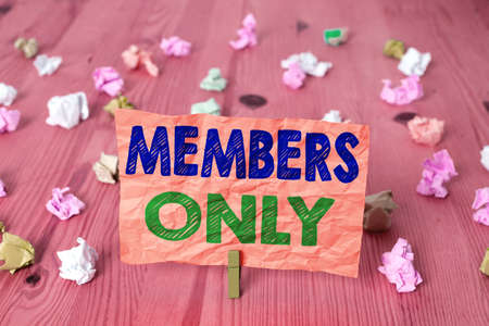 Writing note showing Members Only. Business concept for Limited to an individual belongs to a group or an organization Colored crumpled rectangle shaped reminder paper light blue background