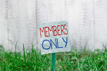 Handwriting text Members Only. Conceptual photo Limited to an individual belongs to a group or an organization Plain empty paper attached to a stick and placed in the green grassy land