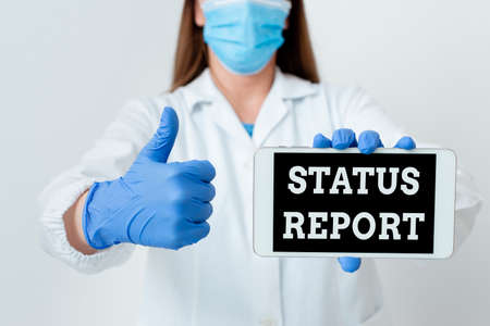 Text sign showing Status Report. Business photo showcasing summarizes the particular situation as of a stated period Laboratory technician featuring empty sticker paper accessories smartphone