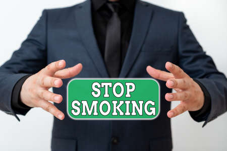 Word writing text Stop Smoking. Business photo showcasing the process of discontinuing or quitting tobacco smoking Model with pointing hand finger symbolizing navigation progress growth Фото со стока