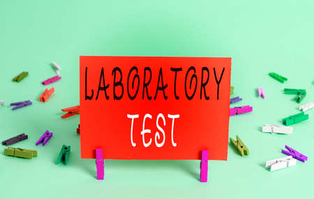 Text sign showing Laboratory Test. Business photo showcasing Determination of a medical diagnosis from the substances tested Colored crumpled rectangle shaped reminder paper light blue background Banque d'images