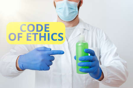 Writing note showing Code Of Ethics. Business concept for basic guide for professional conduct and imposes duties Laboratory Blood Test Sample Shown For Medical Diagnostic