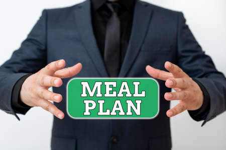 Word writing text Meal Plan. Business photo showcasing act of taking time to plan any number of meals for the week Model with pointing hand finger symbolizing navigation progress growth