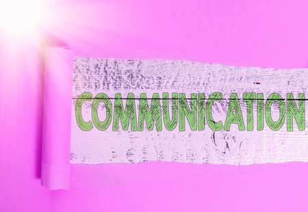 Text sign showing Communication. Business photo showcasing information is exchanged between individuals through a system Rolled ripped torn cardboard placed above a wooden classic table backdrop