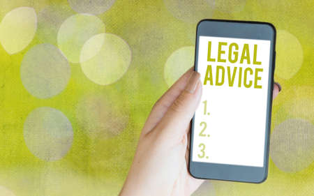 Writing note showing Legal Advice. Business concept for Lawyer opinion about law procedure in a particular situation Modern gadgets white screen under colorful bokeh background
