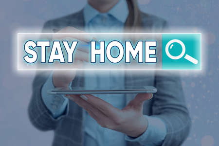 Handwriting text writing Stay Home. Conceptual photo not go out for an activity and stay inside the house or home Web search digital information futuristic technology network connection 版權商用圖片