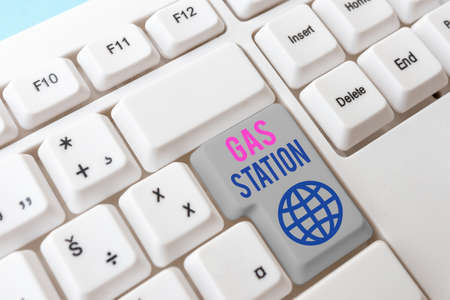 Writing note showing Gas Station. Business concept for for servicing motor vehicles especially with gasoline and oil Different Colored PC keyboard key With Accessories on Empty background Stockfoto
