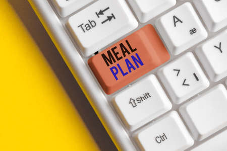 Text sign showing Meal Plan. Business photo showcasing act of taking time to plan any number of meals for the week Different colored keyboard key with accessories arranged on empty copy space