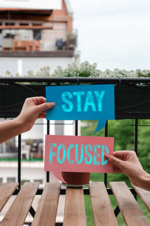 Conceptual hand writing showing Stay Focused. Concept meaning Be attentive Concentrate Prioritize the task Avoid distractions Empty bubble chat sticker mock up emphasizing personal idea