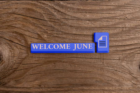 Word writing text Welcome June. Business photo showcasing Calendar Sixth Month Second Quarter Thirty days Greetings Different Colored PC keyboard key With Accessories on Empty background Foto de archivo