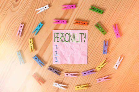 Conceptual hand writing showing Personality. Concept meaning the condition or fact of relating to a particular an individual Colored crumpled papers wooden floor background clothespin Archivio Fotografico