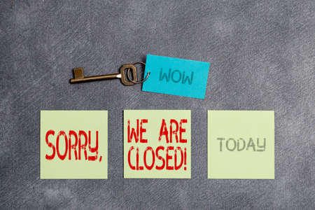 Conceptual hand writing showing Sorry, We Are Closed. Concept meaning apologize for shutting off business for specific time Paper accessories with smartphone arranged on different background Banque d'images