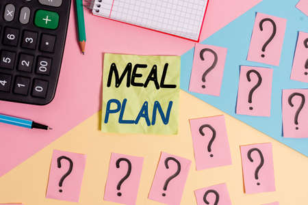 Text sign showing Meal Plan. Business photo text act of taking time to plan any number of meals for the week Mathematics stuff and writing equipment above pastel colours background Stok Fotoğraf