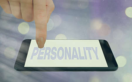 Conceptual hand writing showing Personality. Concept meaning the condition or fact of relating to a particular an individual Modern gadgets white screen under colorful bokeh background Archivio Fotografico