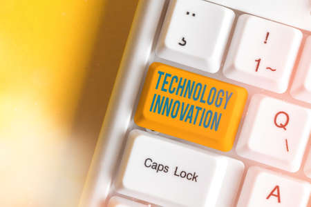 Text sign showing Technology Innovation. Business photo text significant technological changes of products Different colored keyboard key with accessories arranged on empty copy space 免版税图像